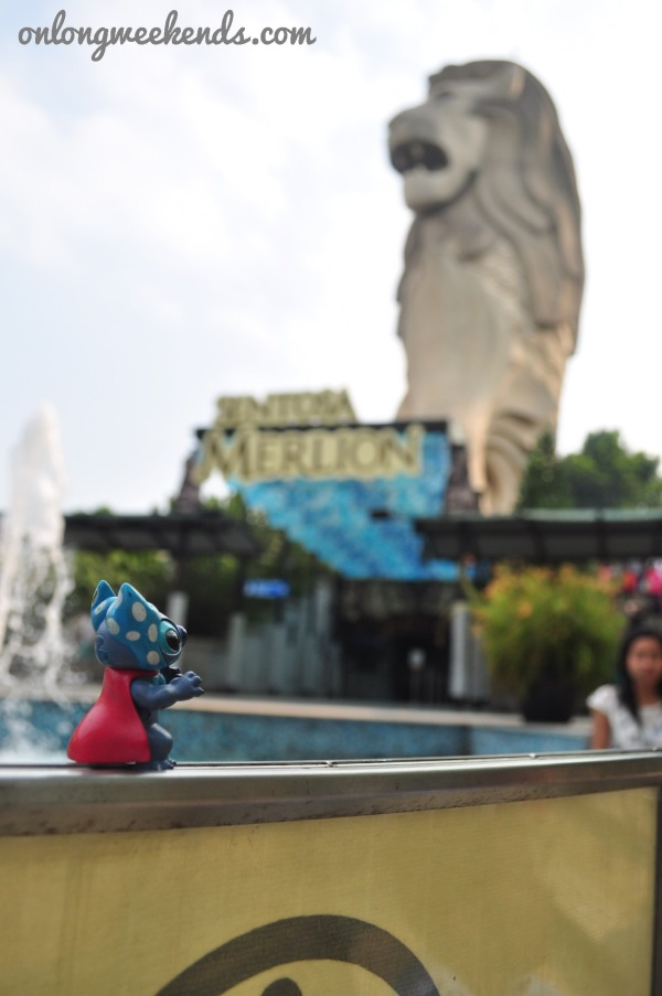 Stitch scaring the Merlion at Imbiah.