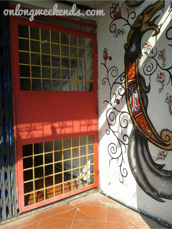 Crimson gate of our guesthouse.